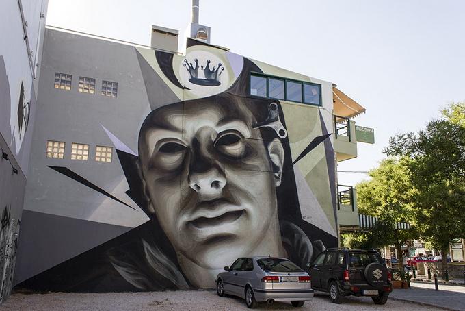 Уличный художник iNO