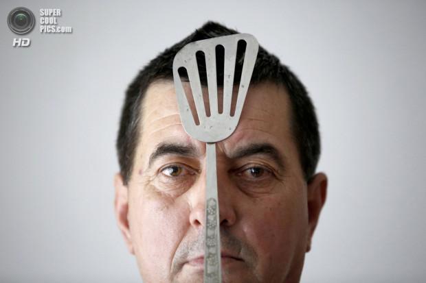 Buljubasic, 56, poses with cutlery on his head in Srebrenik
