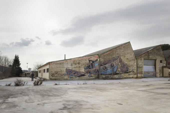 Уличный художник Aryz