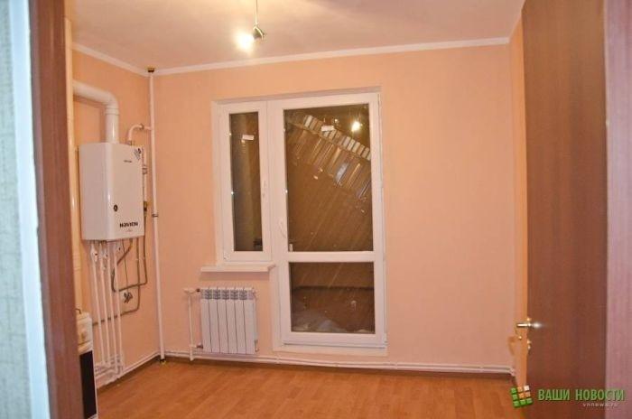 В квартирах, подаренных ветеранам, обрушились балконы (13 фото)