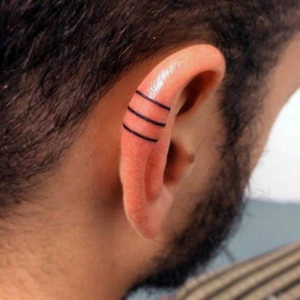 Татуировки на ушах (35 фото)