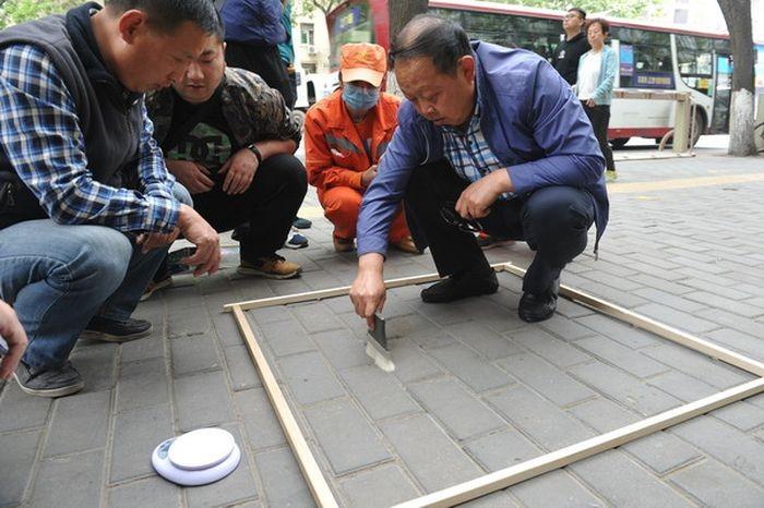 В Китае оценивать качество работы дворников будут взвешиванием пыли (2 фото)
