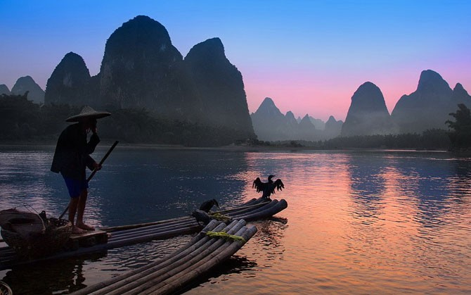Китайская традиционная рыбалка с бакланами (12 фото)