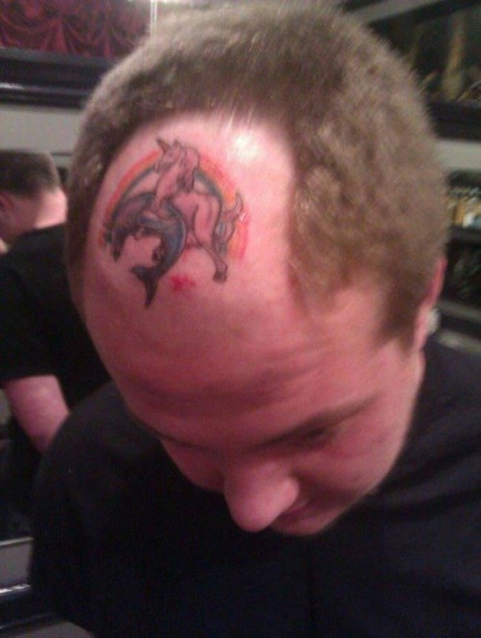 Странные татуировки на голове (21 фото)