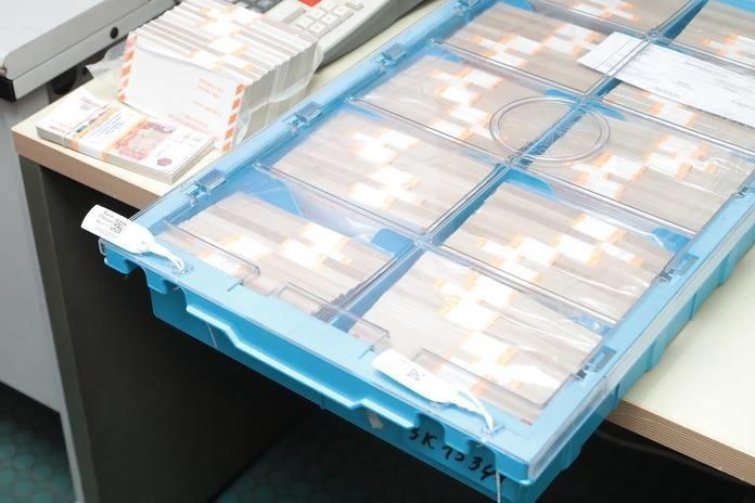 ЦБ показал, как уничтожаются банкноты (6 фото)