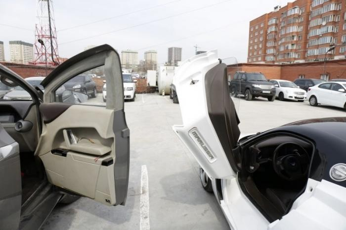 Спорткар и внедорожник Marussia в Новосибирске (16 фото)