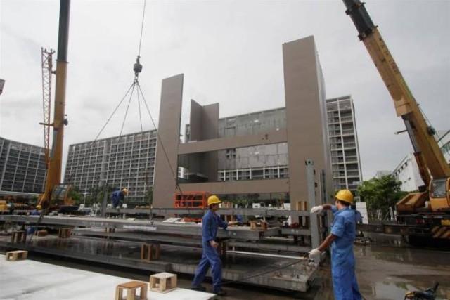 Строительство 4-этажного здания всего за одну ночь (4 фото)