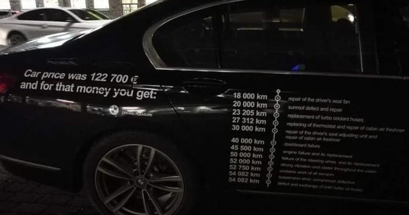 Владелец BMW со зла расписал все поломки на двери своего авто